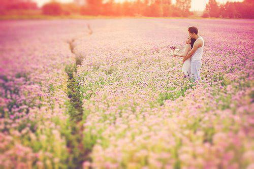 Lovers in a field of flowers
