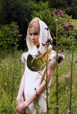 Elsa Sylvan in hooded wool dress by Fendi and necklace by Tom Binns, photographed by Lina Scheynius for Elle US September 2008.