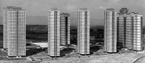 The Red Road flats, Glasgow, Scotland (circa 1969). The Red Road flats complex was one of the most ambitious schemes built by the Glasgow Corporation to tackle the housing crisis in the city created as a result of the slum clearances in the inner city. They were, at the time, the tallest residential blocks in Europe and the estate was planned to house nearly 5,000 people. The estate fell into decline rapidly, initially due to economic depression bringing about further socio-economic problems. The use of asbestos to protect the unique steel structures of the blocks also caused further issues. The blocks have now been condemned for demolition and the first was brought down today using explosives.
