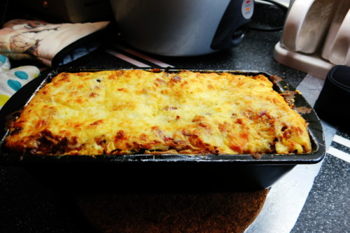 chicken and ham lasagna serves 4 Recipe: 4 lasagna sheets pre cooked 40g grated parmesan 2 garlic cloves crushed 1/2 onion chopped 150g sliced brown button mushrooms 150g minced chicken 60g choped bacon 250g canned chopped tomatoes 1tbsp fresh basil leaves 4tbsp ketchup Bechamel sauce: 300ml milk 3.3 tbsp flour +butter 180C Heat oil in saucepan, add garlic, onion, mushrooms, stir until cooked 4 min.  Add minced chicken, bacon, stir until cooked 5 min. Stir in tomatoes, basil, tomato puree into mixture in saucepan, and ketchup. Season with salt and pepper, cook for 5 min. Make bechamel sauce: Melt butter in saucepan, add flour, stir until combined. Remove from heat. Add milk, stir. Return to heat and boil. Remove from heat, gradually whisk in egg. Stir in half of parmesan cheese. Grease a loaf pan 8x4in. Put one lasagna sheet on the bottom, add some mixture, then bechamel sauce. Repeat with layer, mixture, sauce. Ending with lasagna sheet then sprinkle remaining parmesan. Bake for 35min until golden brown and bubbling.