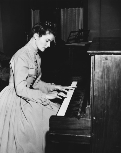Katharine Hepburn playing the piano.