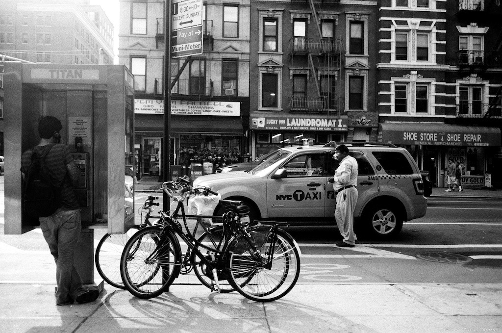 NYC, New York:  May, 2012.  Who uses a payphone?  Weed delivery service guy?  Leica MP.  35 'lux.    Fuji Neopan 400 (with ND).  Lab scan.  Aperture.