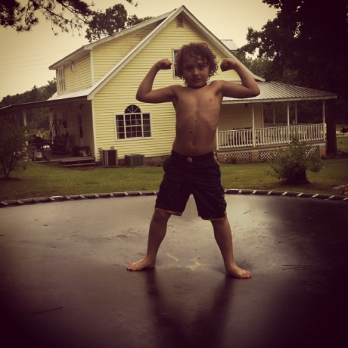 Mr. Muscles jumping in the rain #matthias #matty #babyboy #muscles (Taken with Instagram)