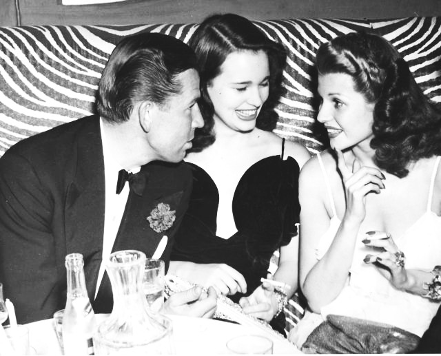 Rita spotted chatting at the Morocco nightclub in 1941.