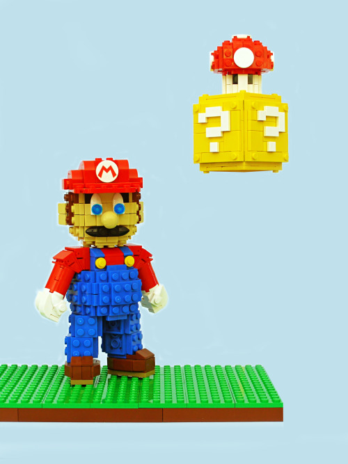 otlgaming:  THIS MARIO IS A CHIP OFF THE LEGO BLOCK Legohaulic's latest commissioned sculpture is this magnificent Super Mario and Question Block with Mushroom.  This highly detailed work of art is a sight to behold.  (Source: Legohaulic's Flickr) Like video game LEGOs?  Pokemon LEGOs || Portal LEGOs