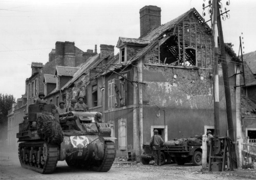 A Howizer, Carentan, France, June 1944.