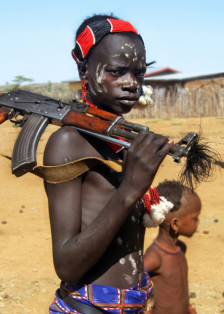 simply-war:  Hamar boy with Kalashnikov II by david schweitzer on Flickr.