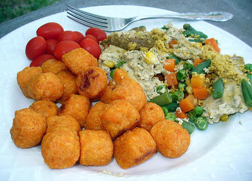 (Last night's) Dinner! Baked tofu scramble (based on the Tater Tot Breakfast Casserole in Lane Gold's Vegan Junk Food ), topped with some diy parmesan cheese (also from VJF – put parmesan on ALL the things! ) and served with sweet potato tots and some teensy tiny salad tomatoes. I love summer!