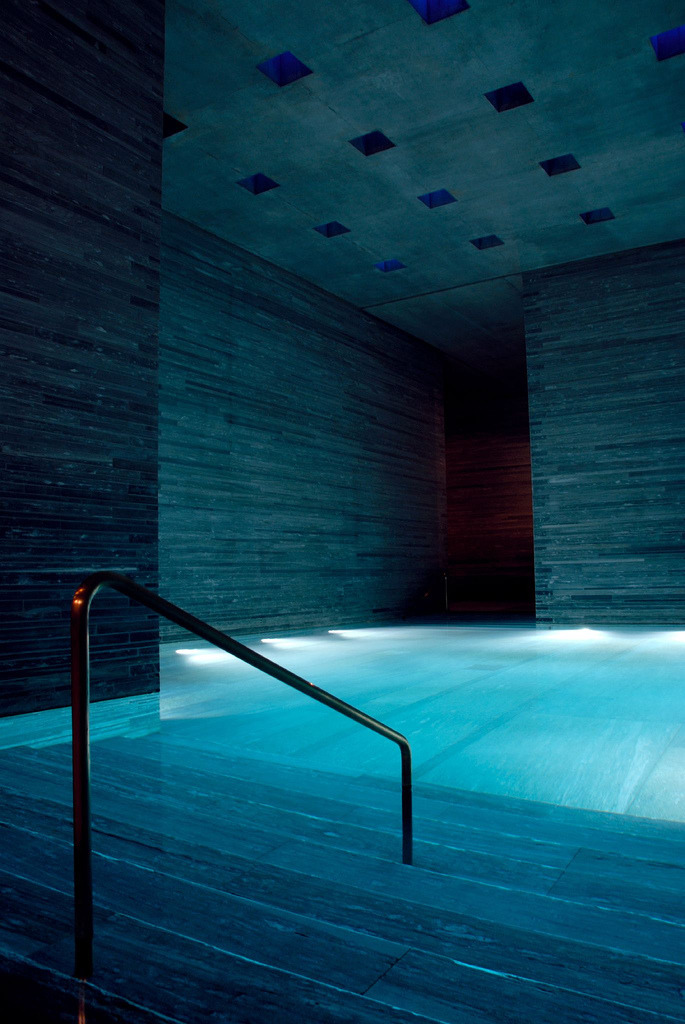 vanished:  Therme Vals is the hotel/spa complex in Vals, built over the only thermal springs in the Graubünden canton in Switzerland. Created by Swish architect Peter Zumthor. This photograph was taken by Amir Korour.