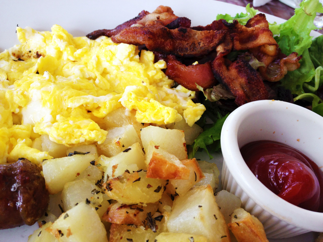 Man's brunch: eggs, sausage, and bacon! From Nido. -Gastrodamus