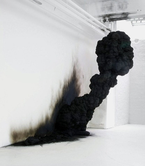 """Spontaneous Combustion"" (2009) is an installation made out of resin and soot by Polish sculptor Olaf Brzeski."
