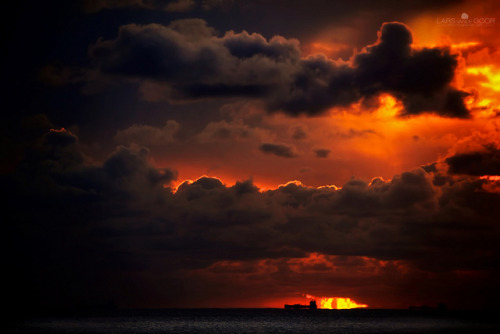 newclearfusion:  Dark Clouds & Ship by larsvandegoor.com on Flickr.