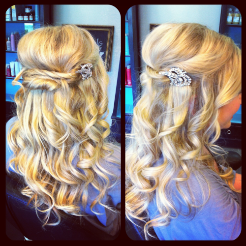 Lovely bridal hair! Yesterday, I had the honor of styling my client and friend, Emily, for her wedding! We did a 1/2 up look with lots of waves and soft twists. I love the vintage brooch turned hair clip she brought. Emily was a gorgeous bride! Congratulations to the Curry's!