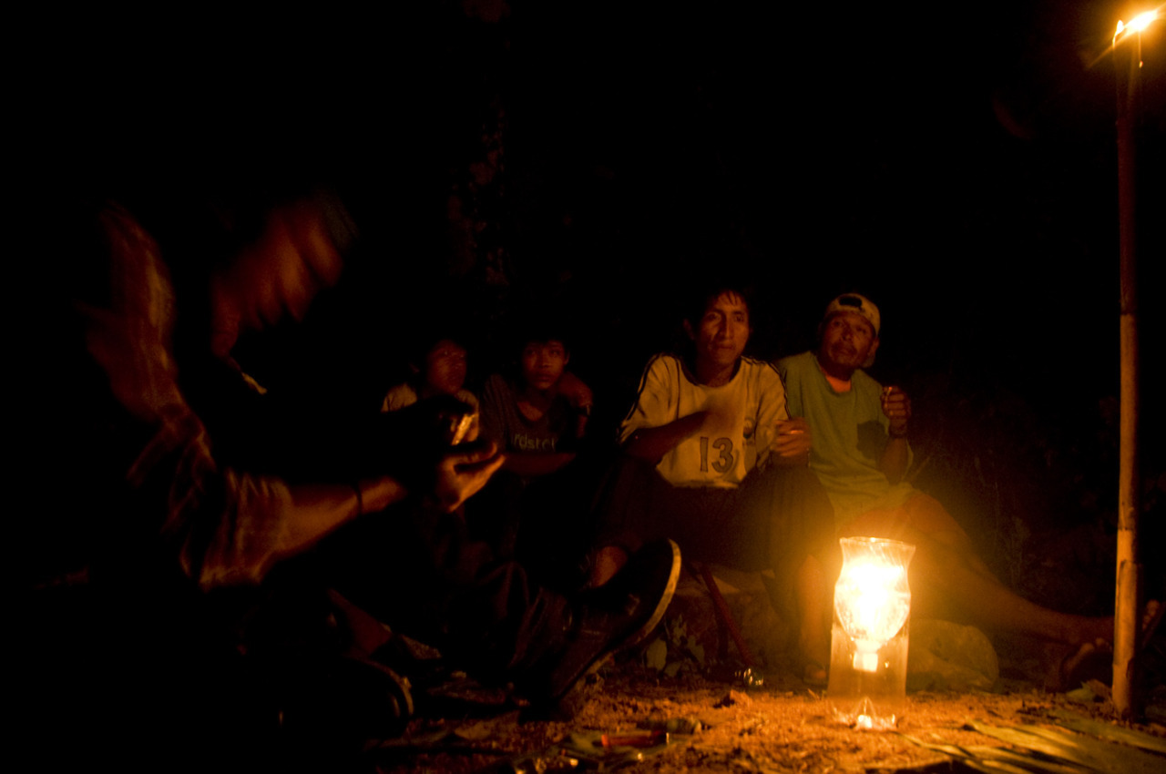 Intercambio Our first night in the jungle, members of the indigenous community stopped by our campsite to welcome us. They played the flute, passed around a bottle of rubbing alcohol (96 percent) and talked about the challenges of living in the Amazon. The community had a school, but no teachers. A river, but no potable water. And the wild pigs weren't coming around as often as the used to. We also learned that less than three decades ago, it was common for boys to get married and start families between the age of 12 and 14. Today, they wait a little longer. Charka Indigenous Territory in Pilon Lajas Nature Reserve - Amazonia, Bolivia  - © Diego Cupolo 2012