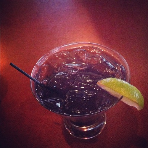 Purple Rain ☔ #ladiesnight #drink #alcohol #instashot #instadrink #instagood #instamood #happysaturday #happyhour #iphoto #iphone4 #Smirnoff #vodka #sourpuss #raspberry #bluecuracao #limecordial #lime #yummy #refreshing #kelseys #cocktail (Taken with Instagram)