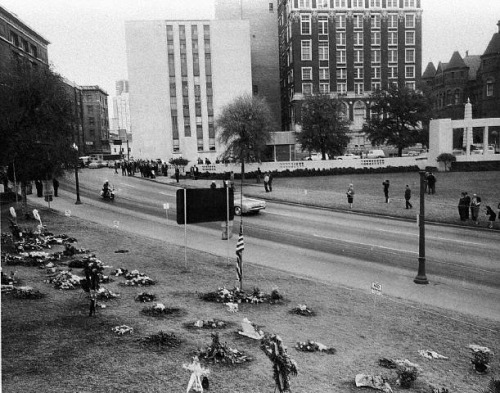 The image above is the very same Dealey Plaza on a much darker day of November 23rd 1963 taken from the Zapruder pedestal the very same spot it was all filmed from.  This image shows the angle of the sign.  Without going into much detail about how this was faked on the Zapruder film, you can clearly see it's not quite right.  Why?  In my humble opinion. Zapruder's lens captured the umbrella man.  What side is the umbrella man actually standing on? Is he between the limo and the sign? Or is he between Zapruder and the sign??? Was the sign put there to conceal this?