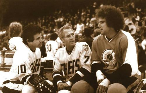 Paul Newman (centre) on the set of Slap Shot (1977).
