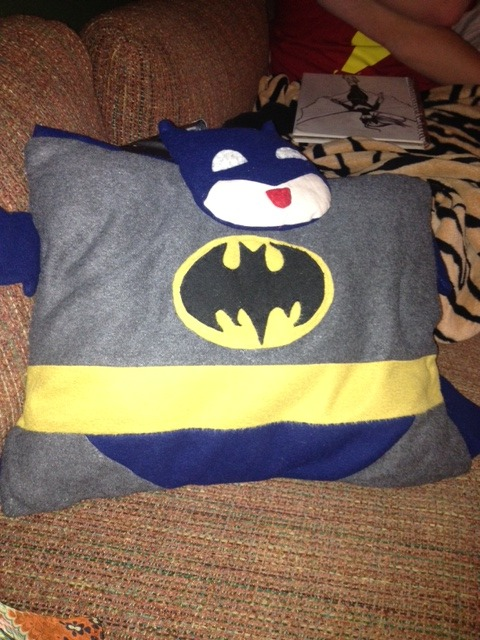 Tumblr, I need some help. I bought this Batman pillow at acen 2012, I can't seem to find the original artists alley dealer that had this ANYWHERE, I'd really like to tell them how much I love it (as well as see if they would make me a set, that being Booster Gold and Blue Beetle) as I am moving and re decorating my room with a super hero motif. (not that it wasn't before but now I'm turning my room into Gotham/the Batcave) I sleep with this thing every night, it's so cuddly and I love it, it's perfect for me cause I am a side sleeper. BUT I'M A SIDE SLEEPER WHO NEED VARIETY IN HIS SUPERHERO PILLOWSSo if you know who they are please reply and let me know, or put it in my ask box. Ask your friends, ask your family, ask your kids, ask your wife, and/or husbando I really appreciate it (if anyone succeeds they will receive a special prize that I will ship to there house)   So please can you find her for me?