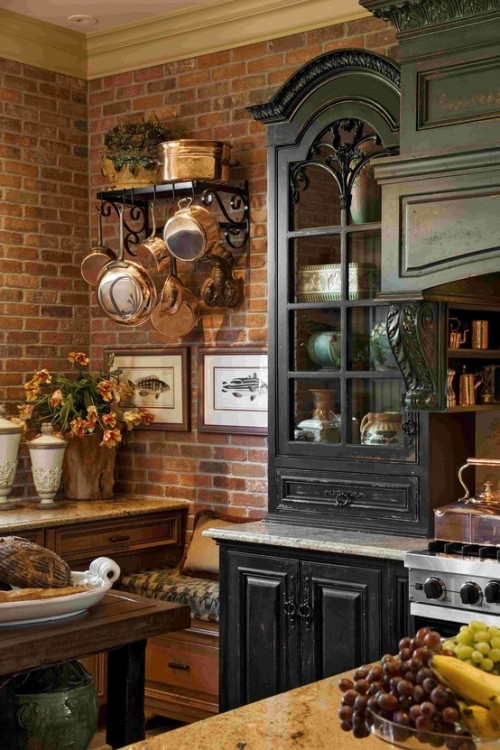 copper and brick walls for a stunning rustic kitchen