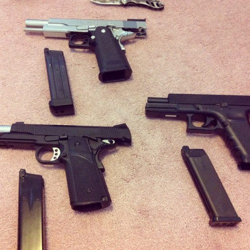 bennanners:  Boys' play things. (courtesy of Colin) #beretta #M9 #Glock #guns #weapons #pistols #callofduty #cod #mw2 #mw3 #blackops (Taken with Instagram)