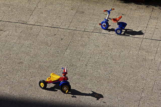 brothers by micmol  on Flickr.Via Flickr: children's toys in the courtyard