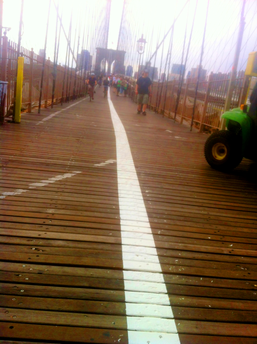 Something new on the Brooklyn Bridge this morning: white lines getting a fresh coat. —A.P.