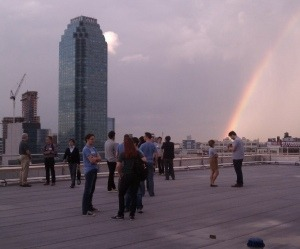 "First Queens Tech Meetup Draws More Than 150 to Long Island City | Betabeat Reddit cofounder Alexis Ohanian stood at the front of a large room at the Hunters Point Plaza Penthouse in Long Island City, and looked out over the rows of tables set up for various startups based in the borough that, let's be honest, doesn't always have the best rep in the city. ""The New York tech community is just starting. There's so much awesome stuff happening in all of New York City,"" he said. ""The only issue I've got is there's a lot of it going on right around here."" He pointed to a map of Manhattan. Speakers and guests alike welcomed the idea of Queens becoming a new hub for digital startup companies at last night's inaugural Queens Tech Meetup. The crowded venue, which featured a rooftop deck looking out over an impressive view of the Manhattan skyline, attracted young professionals in the tech field who exchanged business cards constantly throughout the night. Elias Roman, co-founder of Songza, a streaming music play list service, was equally enthused about the budding tech community in Queens. ""After we got our first company funded, we moved the whole team to Long Island City and we could not be happier,"" he said. The Queens Tech Meetup is hosted by Coalition for Queens, a nonprofit focused on developing the local tech community. New York's tech startups are concentrated heavily in Union Square and Flatiron, with Facebook and Twitter on the Upper West Side and a few hip hubs in Soho (Thrillist, Kickstarter), the West Village (Betaworks) and even Chinatown, where a few companies are clustered in a ratty building they call the ""Silicon Sweatshop."" Brooklyn has got the startup bug, with hubs popping up in Dumbo and Williamsburg. Even Hoboken is making a name for itself with the New Jersey Tech Meetup, which now has almost 2,000 members. Long Island City, primarily known for the Citi tower and, according to Wikipedia, it's ""rapid and ongoing gentrification,"" is not generally thought of as a tech startup scene. ""This is a great location, I don't know why this hasn't become a more popular area,"" said Michael Hillmeyer, an Ozone Park, Queens native and technology software developer. He came to the event because it seemed interesting and he has faith in the potential for Queens, and especially Long Island City, to build up in the next few years. Marleen Vogelaar, COO of Shapeways, a 3-D printing company that is in the process of moving its production site to Long Island City, also presented, bringing along some 3D-printed jewelry pieces, a tiny espresso cup and an iPhone case.""When I came off the subway here from Manhattan for the first time, I just gravitated to Long Island City,"" she said. ""It's a good fit for our company; it's both an industrial and artistic community, it suits us."" Brief Q&A sessions with each of the presenters followed the presentations. The remainder of the night consisted of demos by each of the companies that attended the meetup. Jukay Hsu, founder of Coalition for Queens and the QTM event planner said he was happy with the event's first turnout; he said he had to change the original venue of the event in order to fit more people. But he still hopes to see a bigger presence in the future. ""This is our first event and we had to expand our guest list multiple times,"" he said. ""That's a really great indication of how big this can get and I hope this meetup continues to grow as we host more of them."""
