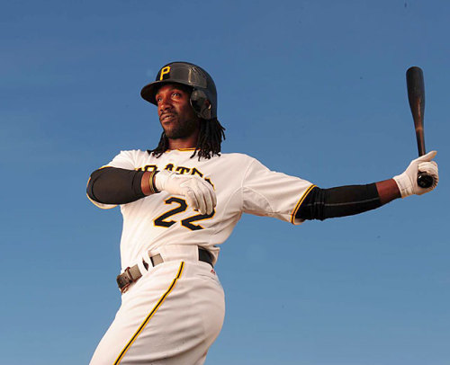 siphotos:  Pirates outfielder Andrew McCutchen poses for a 2011 SI portrait. McCutchen drove in all three runs of Pittsburgh's 3-2 win over Kansas City on Sunday, the team's fourth  straight victory. The Pirates are now tied for first place in the NL Central, the first time they've occupied the top spot this season. (Al Tielemans/SI) LEMIRE: The Pirates are baseball's hottest teamGALLERY: Classic Pics of the Pittsburgh Pirates