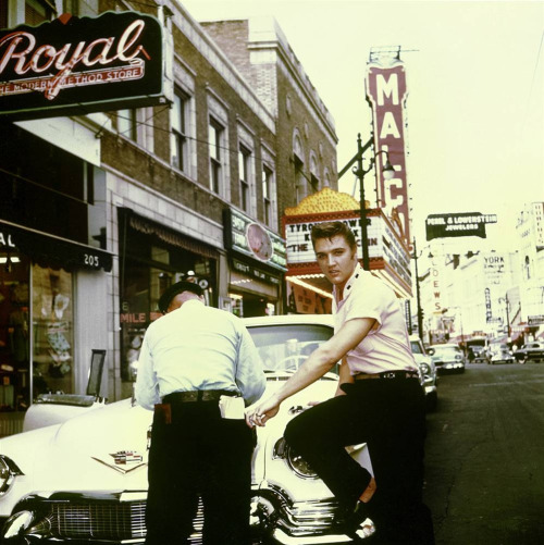 Elvis Presley outside Jim´s Barber shop on South Main street in Memphis, Tennessee, 1956.