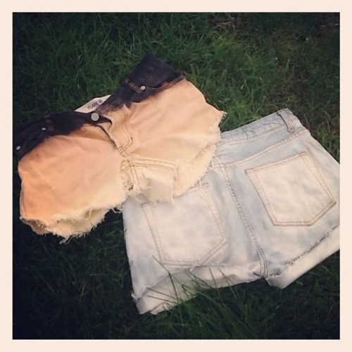 Check out these cool pairs of denim cutoffs that I made. The ombre ones on the left were a pair of black jeans that I cut. When you bleach black denim it turns orange, by leaving the shorts in different concentrations of bleach I was able to get the ombre effect. How cool right?  The shorts on the right were extreme dark wash, really dark denim. Instead of dipping in bleach, I sprayed the shorts. This saved me a lot of bleach and allowed me to focus in on areas where I wanted the shorts to get really light, like the pockets.  Would a denim shorts DIY video be helpful? Let me know! I wouldn't mine doing some more.