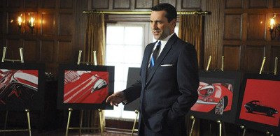 "theatlantic:  The Problem of Marketing Mad Men  In advertising terms, Mad Men is a great product, but a hard sell, and a niche product at best. Despite Don Draper's dismissal of the idea that ""sex sells,"" AMC's marketing has routinely put the show's sex appeal front and center (the earliest promos for the series spend as much time on an unnamed burlesque dancer as they do on Peggy Olsen). It's a tried-and-true formula that the network revisits every season; earlier this year, Mad Men-promoting taxicabs were emblazoned with the phrase ""Adultery is back,"" which boils the series' five seasons of complex, interconnected professional and personal relationships into a cuckold's version of musical chairs. […] Mad Men's sometimes-uncomfortable relationship with its own advertising and merchandise is a real-life version of the tension between business and creative seen on the series. Mad Men is a complicated show, but advertising, by its very nature, simplifies (which is why AMC's commercials for the show involve a disproportionate amount of sex and punching). How do you market a show about marketing? The lesson offered by Mad Men's advertising and merchandise is a simple one: When in doubt, go with authenticity. AMC has always done best by Mad Men by emulating the advice given by Don Draper in the series' most famous pitch: ""Nostalgia… it's delicate, but potent."" Read more. [Image: AMC]"