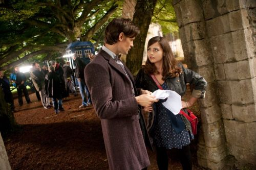 doctorwho:  Matt Smith and Jenna-Louise Coleman on set. Here's the second photo of Matt Smith and Jenna-Louise Coleman on location at Margam Country Park. Jenna takes over as the Doctor's companion from this year's Christmas special.