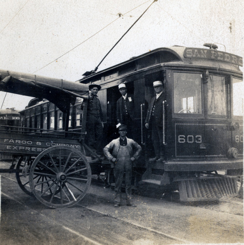 Pacific Electric and Wells Fargo & Company Express on Flickr. circa 1905 Pacific Electric Railway motormen pose on car 603 to San Pedro with employees of Wells Fargo & Company Express.
