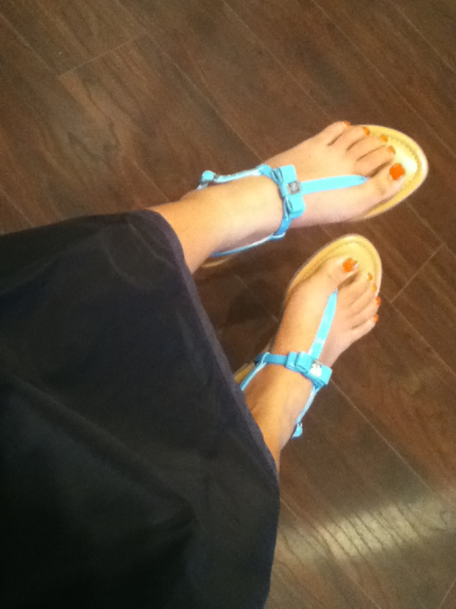 Look my thin girly feet. Wearing my BCBG bow detail sandals and Essie limited edition 'Orange, it's Obvious!' nail polish! The black robe is from the hair salon I regularly go to. Got my hair done today, and I took this while I was waiting for the hair treatment to be finished.