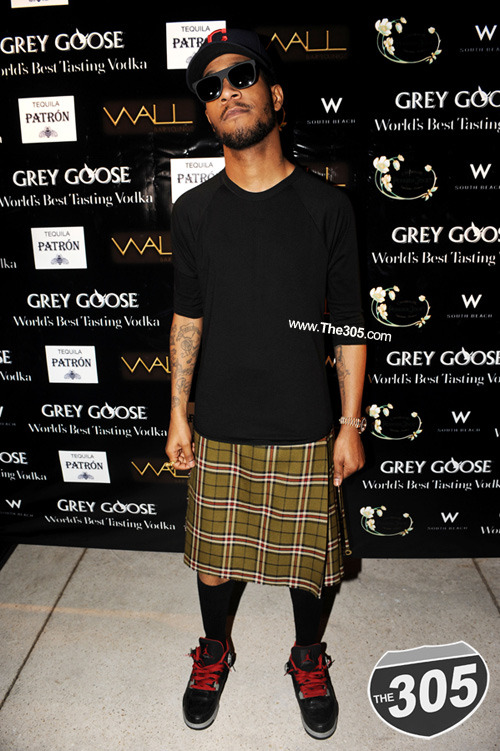 "Look Of The Day- ""I'm the man in a Kilt forget pants""- E Royal… Kid Cudi has this pot head rugged looked all chic-ed out. He reminds me of a corner boy, the only one with any actual job. He would probably be the dude to introduce the leased Lexus drivers to Atrium and INA. Just an all around dope kid. Marc Jacobs couldn't rock this look if he smoked a milli blunts."