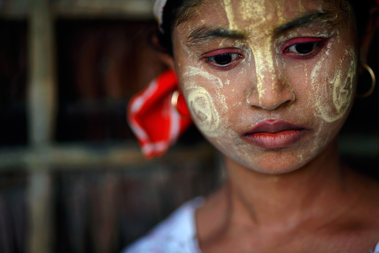 From Burma In Transition, one of 39 photos. Here, an ethnic Rohingya girl wears traditional make-up in the village of Takebi north of the town of Sittwe, on May 18, 2012. Some 800,000 Rohingya live in Burma's northern Rakhine State under severe government restrictions that human rights monitors believe has fueled the current violence between predominantly Buddhist and Muslim communities that left a number of dead and houses burnt on both sides. (Reuters/Damir Sagolj)