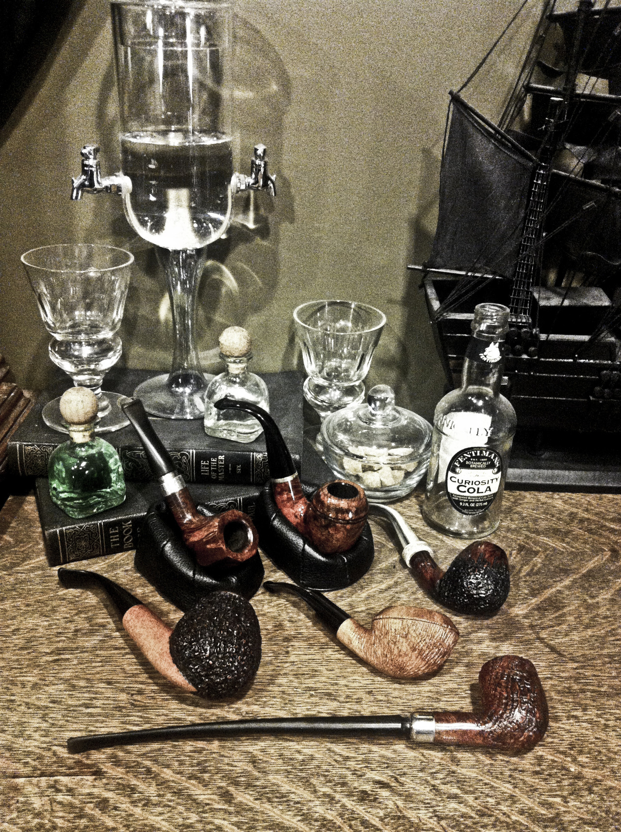 busterboyd:  My tobacco pipe collection so far.  I have since added another fine Ascorti pipe to the ranks.   The bend on that pipe in the stand on the right… come to me…