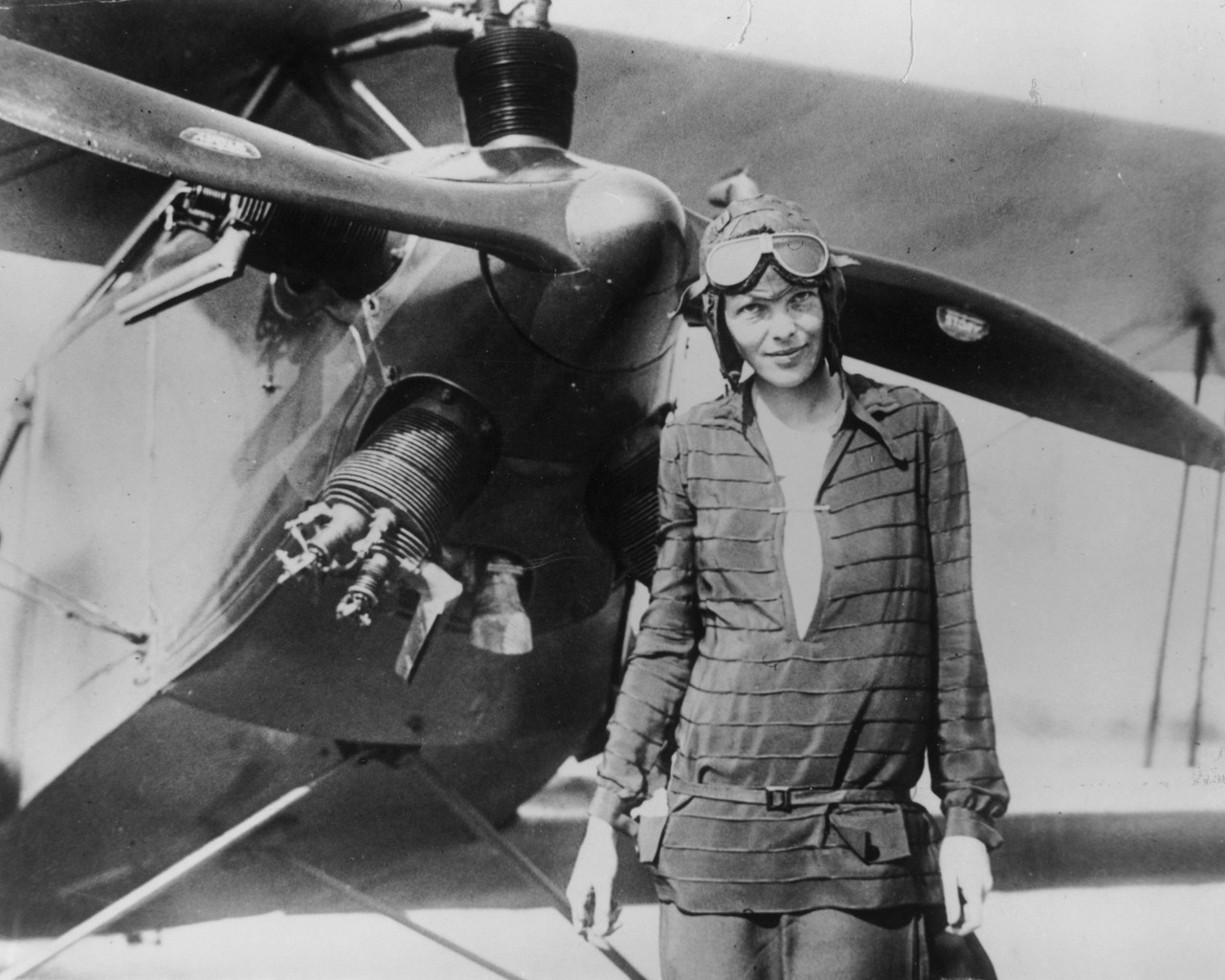Amelia Earhart in front of her first airplane, a Kinner Airster, c. 1921
