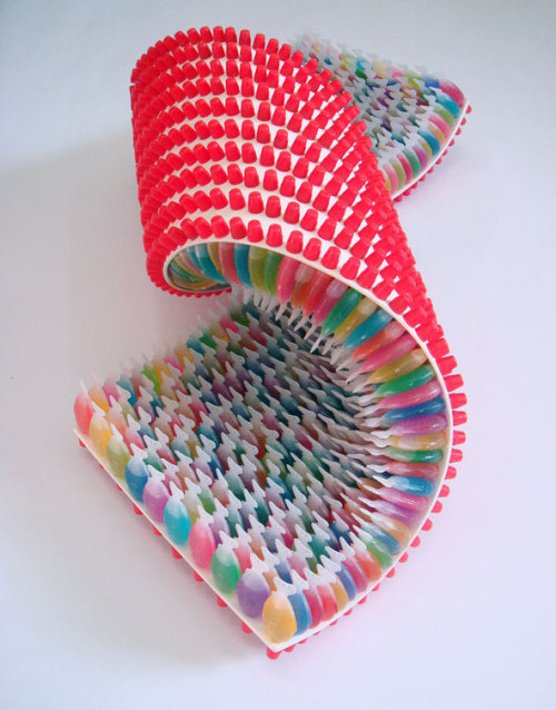 Sculptures made from plastic fish-shaped soy sauce containers filled with colored water by Japanese art collective Three Studio. Follow them on Tumblr