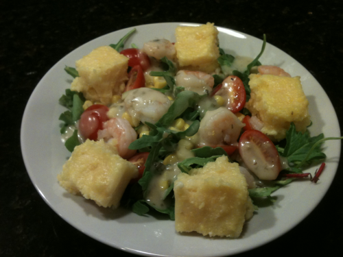 "The AMAZING shrimp and polenta arugula salad that Ev and I made for dinner last night…  but we all know who REALLY made it while a certain unnamed boyfriend ""studied"" ;)"