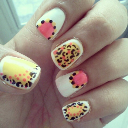 Leopard and polka dot design. #manicureMonday #manicure #nailart #leopard #polkadots #trend #bright #orly #zoya #revlon #nailpolish  (Taken with Instagram)