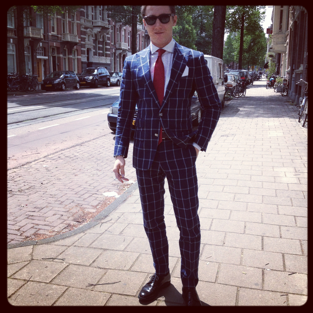 Mattia, our MTM specialist in Milan, on a break outside the store in Amsterdam.