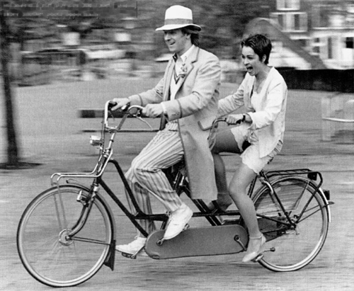 From Doctor Who in the 80s, Peter Davison and Janet Fielding enjoy a tandem ride