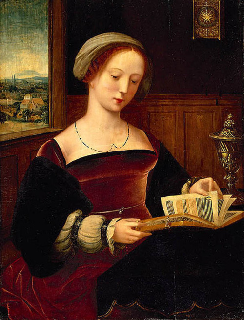 books0977:  St. Mary Magdalene Reading (c1525-1550). Artist not known, described as Master of the Half-Figures (Dutch, active in the first third of the sixteenth century. Oil on wood. Louvre Museum. Department of Paintings. Acquired in Brussels in 1834. St. Mary Magdalene, recognizable by the attribute, the box of ointment, is represented in a domestic context which approximates portraiture; her clothing is after the fashion of the 1520s, and the clock hanging on the wall, referring to time passing, doubles as an allegory of vanity.