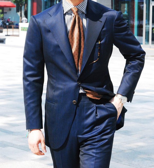 "The dapper gents from Seoul's ""Tailor Shop"".  Gorgeous blue suit with brown tie"