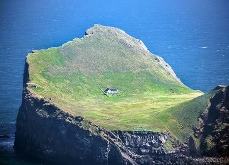 From 12 Most Amazing Secluded Houses:  Really lonely house on one of the isles of Vestmannaeyjar.Shot through a plane window.Elliðaey, Vestmannaeyjar, Iceland. (Link)