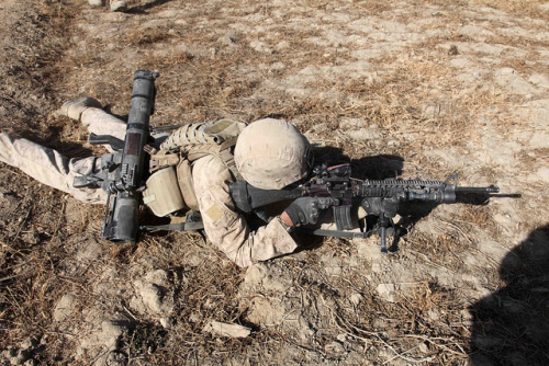 A Marines scans the area for the enemy by United States Marine Corps Official Page on Flickr.