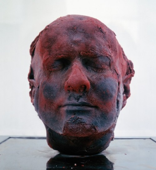 "Back in 1991, Marc Quinn started one of the most bizarre art projects in history – making detailed self-portraits from his own frozen blood. He has been making a new one every five year or so, since then. Yes, they're creepy, but think of it this way – it must be reassuring for Mark to know that if he ever needs a transfusion, he's got a few gallons of blood he can use. Marc Quinn created his ""Self "" series as a means of recording the changes of his face throughout the years, such as countenance and ageing, and if you look closely at the four blood portraits he has made so far, you'll notice his face has indeed matured over time. Of course, he could have used a more common material for his artworks, but the message wouldn't have been as powerful as using his own blood. According to Scientific American magazine, ""by crafting these heads out of his own blood, Quinn reconnects us to the the fact that in the fullness of time, no artist's attempt at immortality through self-portraiture will prevail. And of course the series will presumably end in the course of the artist's life, so the artwork's time-dimension has a death of sorts as well."""