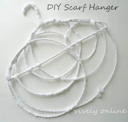 storagegeek:  I Love this 'freestyle' wire scarf holder from Vively Online. Serious bonus points for wrapping it in scrap fabric.