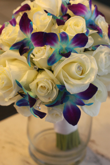 morrisonx3:  Morrisonx3:White Roses with Blue Orchids for wedding bouquet.
